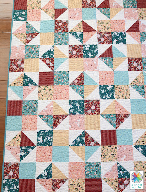 Four Patch Spin free quilt pattern by Andy of A Bright Corner - a easy, fat quarter friendly lap size quilt