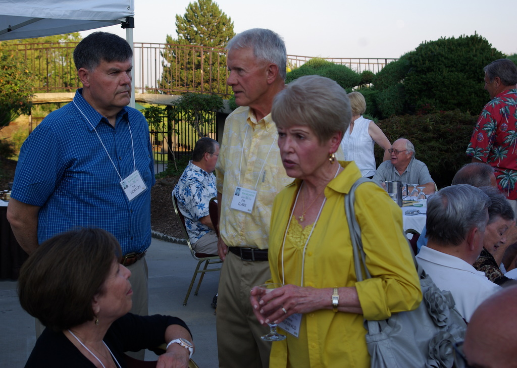 Barbara and Jim Horton talking to Jim Clark and Connie Grunwald Clark