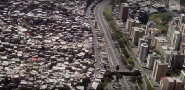 Screenshot of the Pentagon Video 'Megacities: Urban Future, the Emerging Complexity', showing a shanty town next to a developed business district. This five-minute video has been used at the Pentagon's Joint Special Operations University. Photo: U.S. Department of Defense / The Intercept