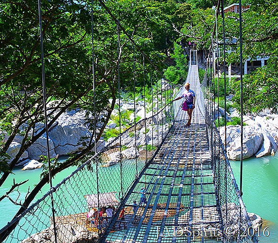 Me on the middle of the hanging bridge despite my fear of heights