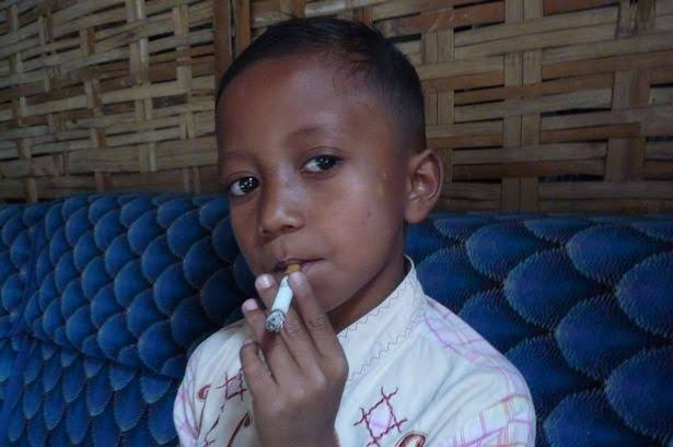 #News: A 2 years old boy caught on camera smoking shesha