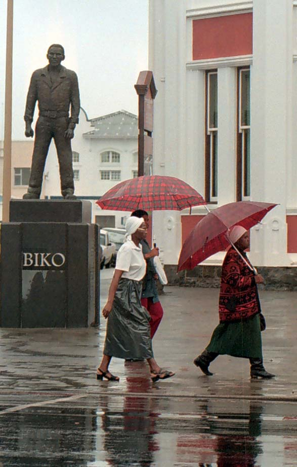 Women walk past the statue of Steve Biko in East London.