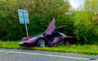 The McLaren F1 supercar was left as a mangled wreck after Rowan Atkinson crashed into a tree in August 2011.