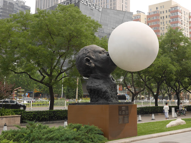 """Black Sculpture"" from ""Three For You"" by Gianni Dessi in front of the Parkview Green in Beijing"