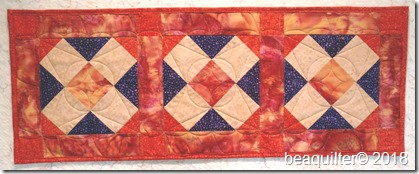 accuquilt batik table runner