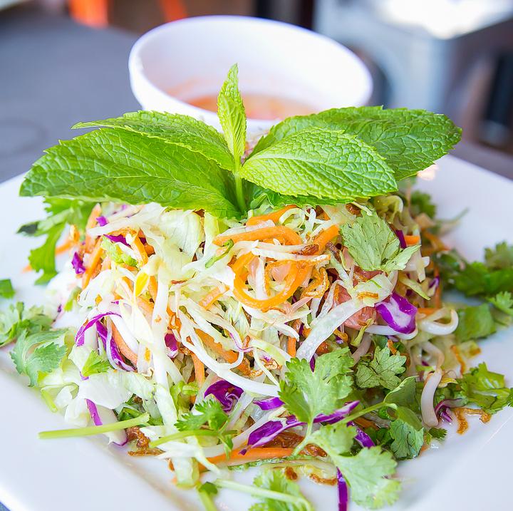 photo of a grapefruit, shrimp and pork salad