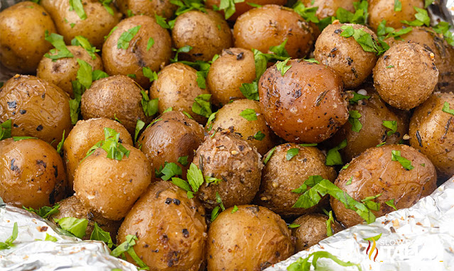 Potatoes On The Grill In Foil close up wide