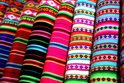 Colorful woven fabric at a store in Cuzco Peru