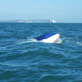 A capsized speedboat during the air show.  Poole lifeboats pulled the 2 passengers out of the water.  31 August 2014.  Photo credit: Poole RNLI