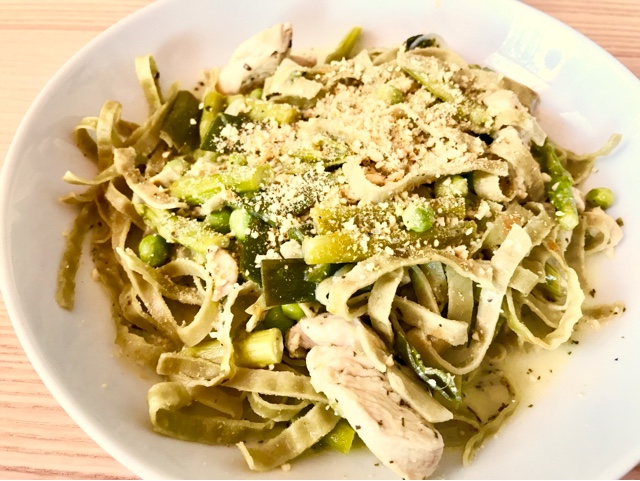 Chicken, pea and asparagus pasta with vegan parmesan