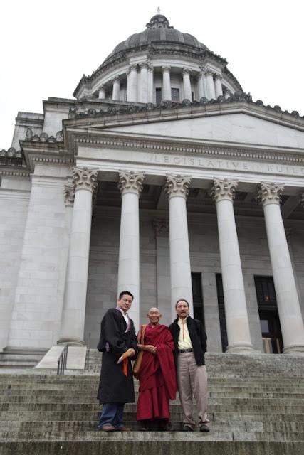 TAW president Jampa Jorkhang, Ven. Palden Gyatso and Ridgzin Tingkhye at the steps of of Washington State's capitol building in Olympia, WA. Photo: Kurt Smith 10/19/11