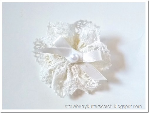 Close up of the pearl and lace rosette broach.