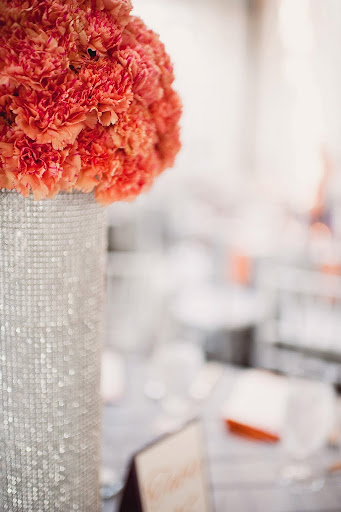 orange carnation high centerpiece