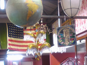 Cieling hung with flags globes and etc