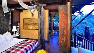 Ruangan kamar dengan view pemandangan alam di Capella Ubud