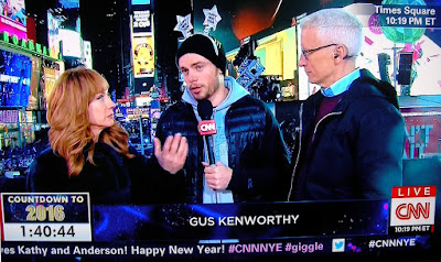 Skier Gus Kenworthy celebrates New Year's Eve 2016, wearing a crazy hat, next to Kathy Griffin and Anderson Cooper on New Year's Eve Live 2016 CNN cable TV show