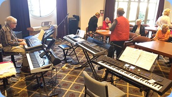 Setting-up the keyboards and seating arrangements.