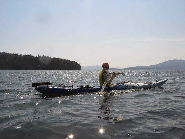 Kayaking commuters on Bellingham Bay appreciate the ease of parking; but the benefits of paddling through nature are similar recreationally: beauty, health and peace.Credit: Peter James
