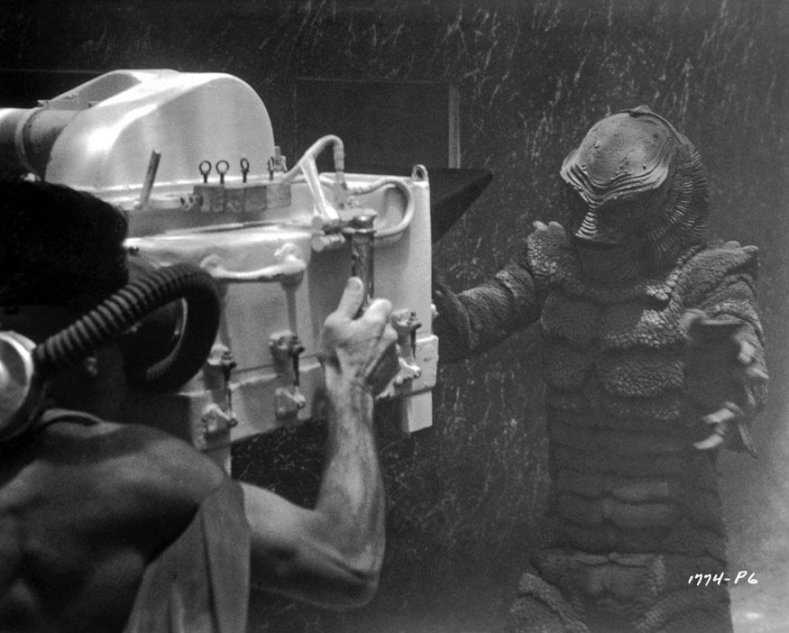 Revenge of the Creature (1955)  Directed by Jack Arnold  Underwater production photo showing Charles C. (Scotty) Welbourne maneuvering his underwater camera