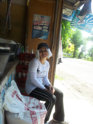 ayn sitting at a sari-sari store in boljoon, cebu, philippines
