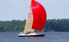 J/100 sailboat- sailing Lake of the Woods regatta under spinnaker