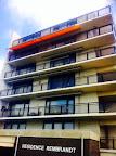 Opal Design knikarm zonwering op Balkon in Noordwijk