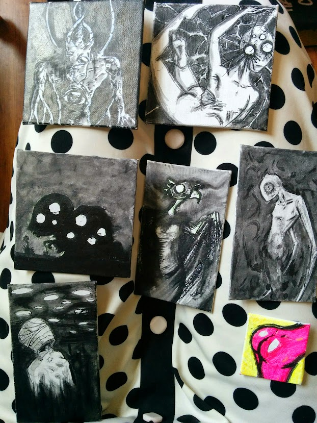 Mini-paintings: black and white monsters and ghosts, as well as a neon pink butt