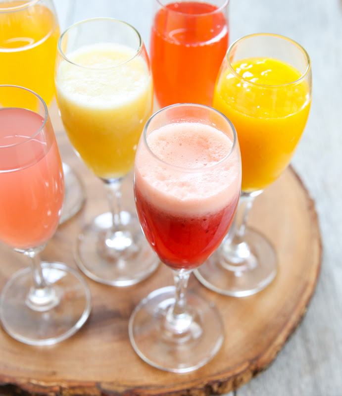 overhead photo of glasses of Non-Alcoholic Mimosas