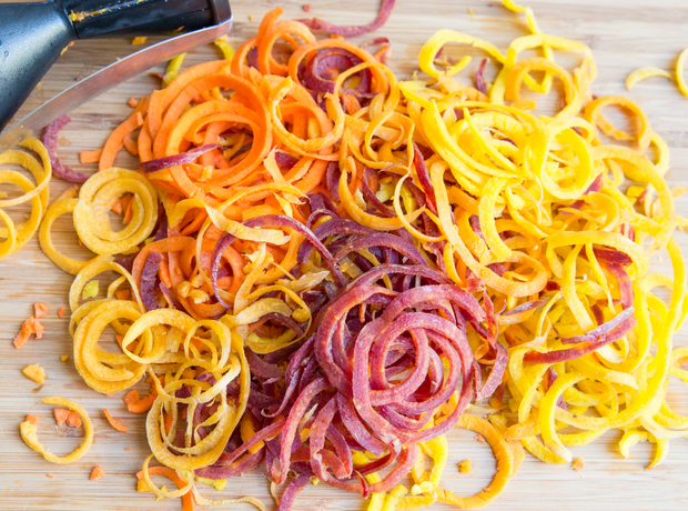 process photo of raw spiralized carrots on a cutting board