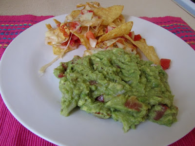 Homemade nachos and guacamole