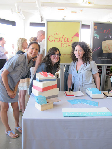 Steph, Athena, and I stand by the Crafts Dept. booth, ready to stamp some passports.  Those boxes are from last August's Dipping story.