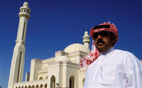 Bahrain - man in front of Grand Mosque  (photo-telegraph.co.uk)