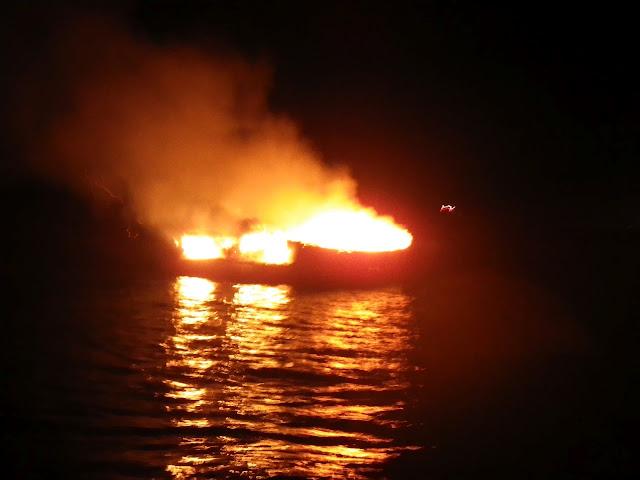 14 September 2012 - fishing vessel alight at Fisherman's Quay.  Photo credit: RNLI/Poole