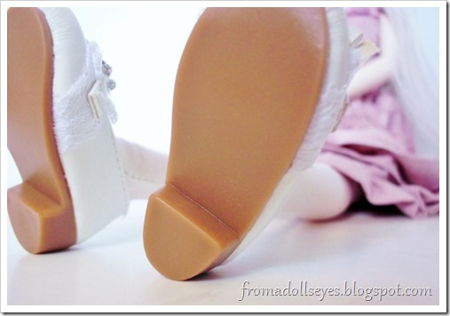 An interesting close up of a doll's shoes.