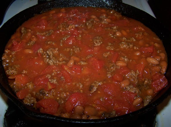 Add beans,tomato sauce and tomatoes (if desired) Heat thoroughly.