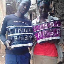 Photo: Lindi-Pesa Chairman and member who made the baskets - preparing for launch in August