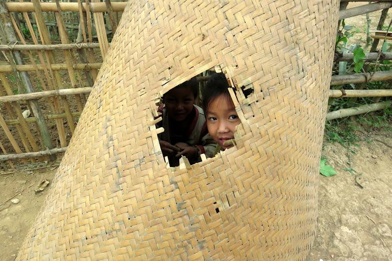 Little girls in a straw mat fort