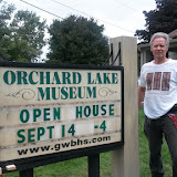 Paul Mellerowicz updates the Orchard Lake Road sign, 2014.