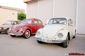 Red and White VW Beetles