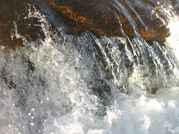 Water flowing over granite.