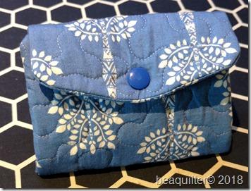 tri fold purse