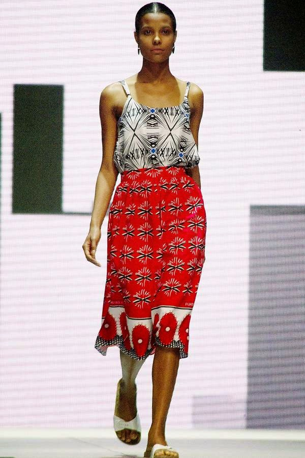 A model presents a creation by fashion brand Lalesso, a collaboration between South African and Kenyan fashion designers, on the third and final day of the Cape Town Fashion Week, at the Cape Town International Convention Centre, on July 26, 2014, in Cape Town.