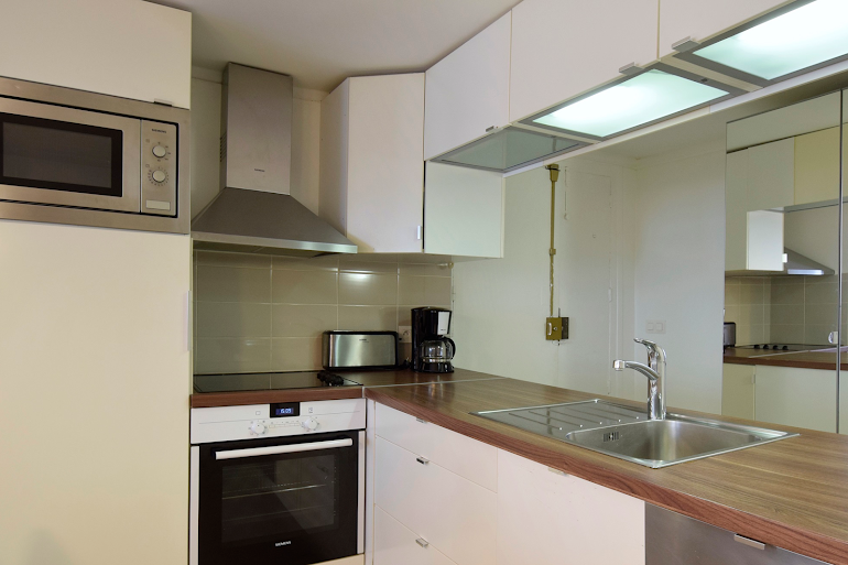 Fully equipped kitchen at Marais & Palais Royal Serviced Apartment, Opera