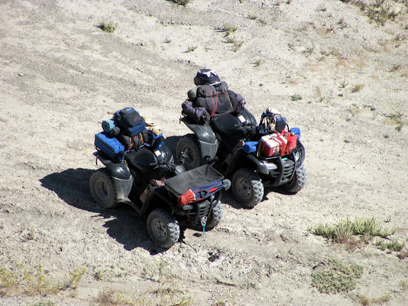 The ATVs parked below