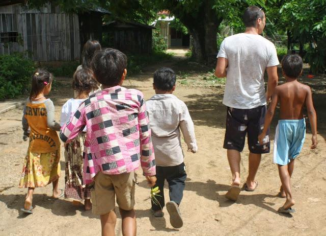 Author Noah Lederman with kids in Cambodia