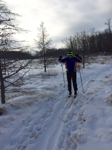 Minneapolis Washburn skier passing in between Twin Lakes on Wavy Gravy trail