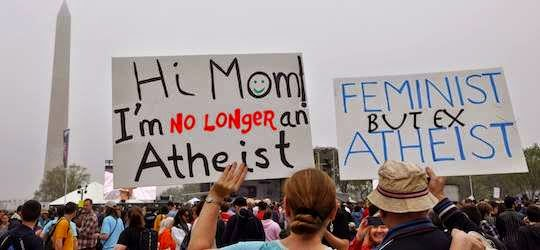 Ex-atheists carrying signs