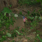 A slave grave with stone & flag marker.