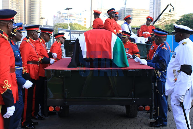 The coffin carrying former President Daniel Moi's body is carried in a military truck on Saturday, February 8, 2020.
