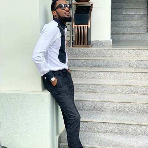 Dbanji steps out in a New style caption
